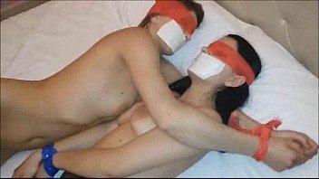TWO HOT BABES KISS THEIR GAGGED LIPS