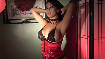 Babe masturbates in stockings gloves and a corset