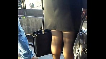 Mature executive with shoes and black pantyhose