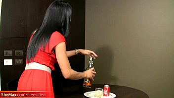 Gorgeous ladyboy in red dress gives a great blowjob