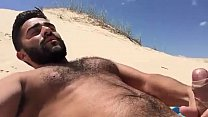Hairy chest cumming in the sand