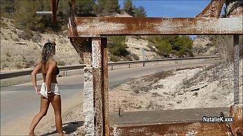 NatalieK pulls off the road to masturabate on the stone on the roadside