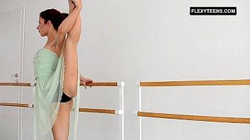 Redhead Zlata doing standing bridges