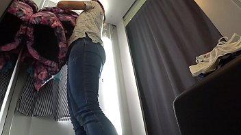 A hidden camera inside the public locker room, a naked girl trying on underwear.