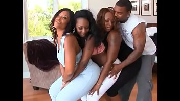 Black babe with big phat ass rides throbbing cock in an orgy