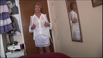 Naughty granny in see through top and slip teasing and flashing