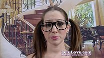 Nerdy girl in big glasses gives dildo blowjob til it cums in her mouth