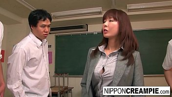 Beautiful Japanese babe is gangbanged in the classroom