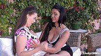 Busty lesbians Emma Leigh & Cherry Blush share a double dong in the garden