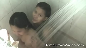 Two petite Asian amateurs sharing a white cock