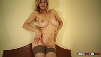 Busty MILF in stockings does some teasing