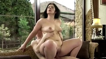 Fat ass mom secretary fucks on the couch with young lawyer son - PornoGozo.com