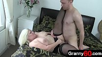 60-years-old granny is home alone feeling extra horny, so she calls on her young lover to come fill her hole with cock