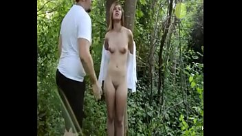 teen Natasja tied and caned in nature