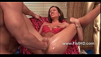 Horny slut Maia takes a big fist up her snatch