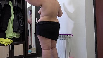 Beautiful BBW in everyday life. Big ass and fat legs under a short skirt. Homemade fetish.