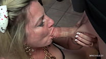 Swinger MILF working two cocks at once in homemade video