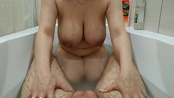 Young girl with big natural tits jerks off and sucks her boyfriend's fat cock in the bathroom