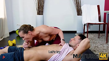 MATURE4K. During training session coach is seduced by his mature client