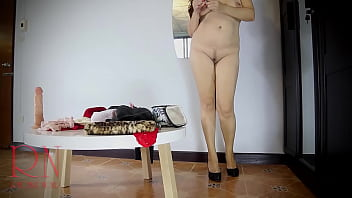 A naked lady does make-up in front of a mirror, puts on underwear, stockings, a skirt. 3