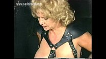 Bending over older slave with big boobs is spanked on her ass with bamboo stick by master