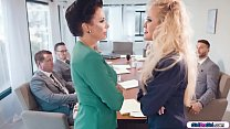 Busty businesswomen licking in boardroom