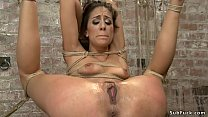 Brunette slave gagged with dildo