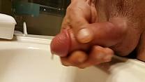 Stroking pumped penis